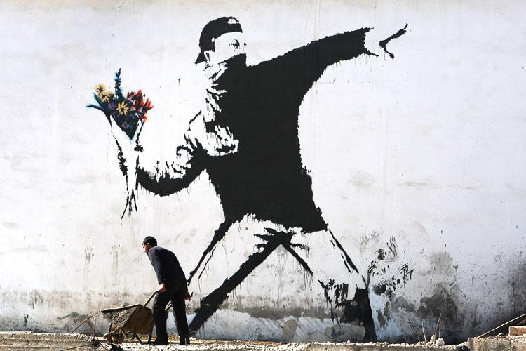 Banksy, pochoir sur un mur en Cisjordanie